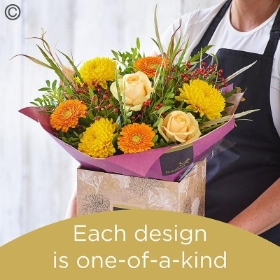 Autumn hand tied bouquet made with the finest flowers.